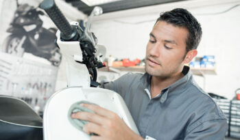 Mechanic cleaning a scooter